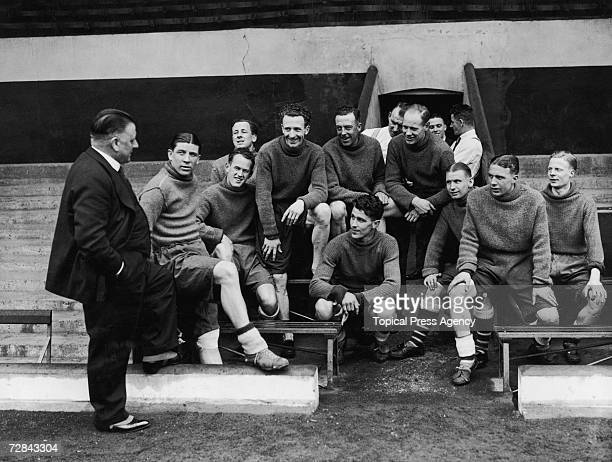 Arsenal manager George Allison talks to the team during a training session at Highbury Stadium before they leave for Huddersfield to play Grimsby in...