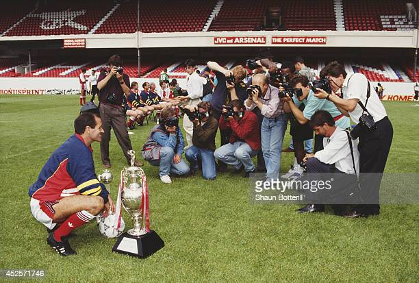 Arsenal manager George Graham poses for photographers with the previous seasons silverware at Highbury on August 1 1991 in London England