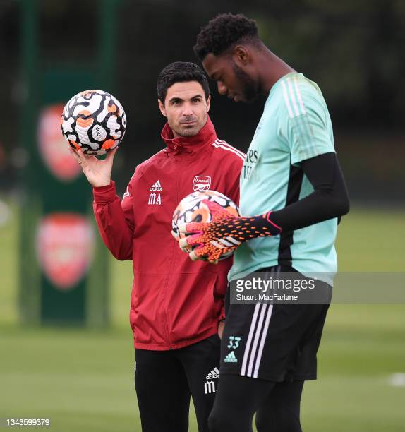 Arsenal manager Mikel Arteta and Arthur Okonkwo during a training session at London Colney on September 28, 2021 in St Albans, England.