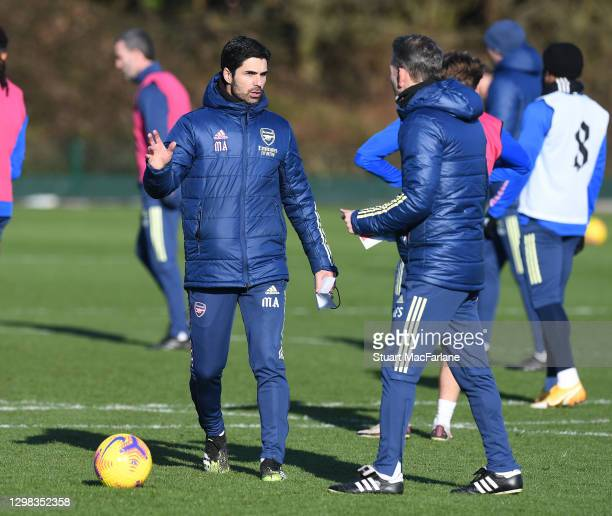 Arsenal manager Mikel Arteta and assistant Albert Stuivenburg during a training session at London Colney on January 25, 2021 in St Albans, England.