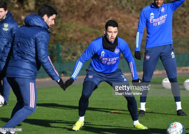 Arsenal manager Mikel Arteta and Gabriel Martinelli during a training session at London Colney on January 22, 2021 in St Albans, England.