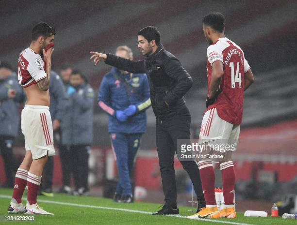 Arsenal manager Mikel Arteta talks to Dani Ceballos during the Premier League match between Arsenal and Aston Villa at Emirates Stadium on November...