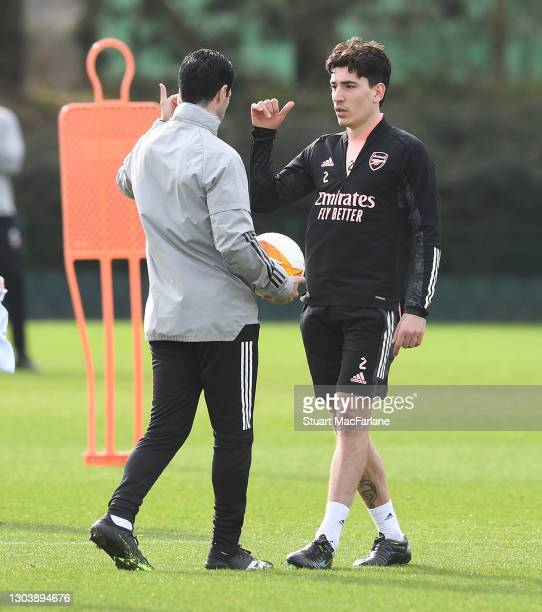 Arsenal manager Mikel Arteta talks to Hector Bellerin during a training session at London Colney on February 24, 2021 in St Albans, England.