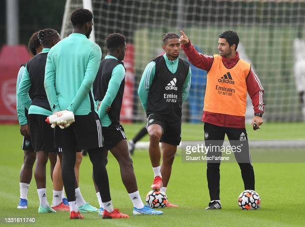 Arsenal manager Mikel Arteta talks to his players during a training session at London Colney on July 30, 2021 in St Albans, England.