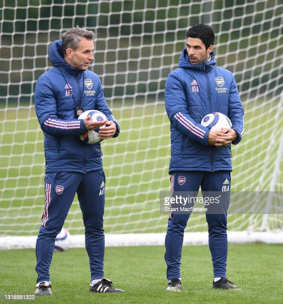 Arsenal manager Mikel Arteta with assistant Albert Stuivenburg during a training session at London Colney on May 08, 2021 in St Albans, England.