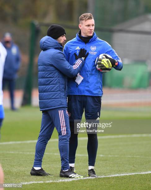 Arsenal manager Mikel Arteta with goalkeeper Bernd Leno during a training session at London Colney on March 05, 2021 in St Albans, England.