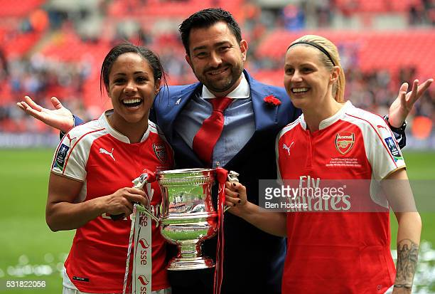 Arsenal manager Pedro Martinez Losa Alex Scott and Kelly Smith of Arsenal celebrate with the trophy following the SSE Women's FA Cup Final between...