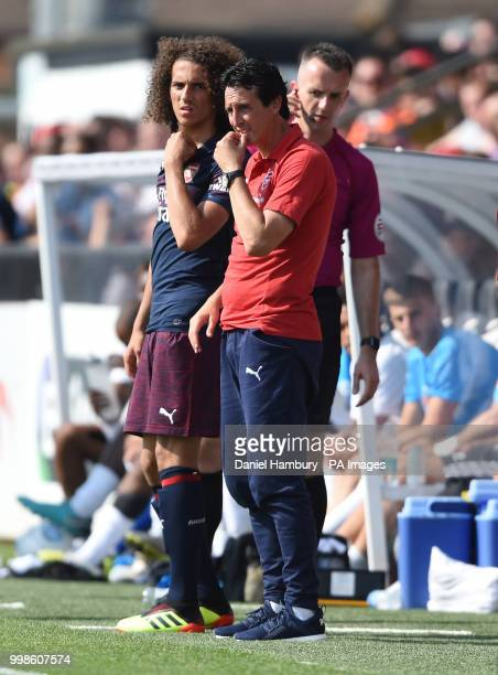 Arsenal manager Unai Emery prepares to bring on Matteo Guendouzi during the preseason match at Meadow Park Boreham Wood