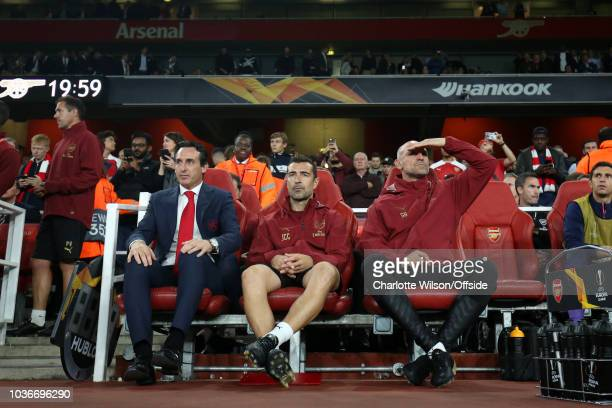 Arsenal manager Unai Emery sits on the bench alongside his assistants Juan Carlos Carcedo and Steve Bould during the UEFA Europa League Group E match...