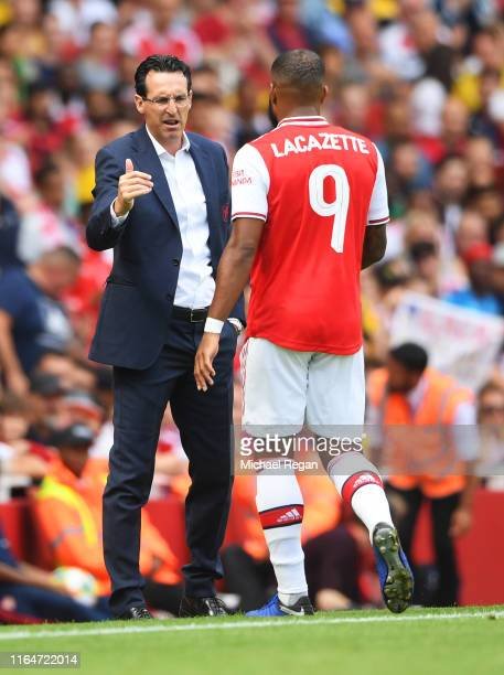 Arsenal manager Unai Emery speaks to Alexandre Lacazette as he is substituted in the first half during the Emirates Cup match between Arsenal and...