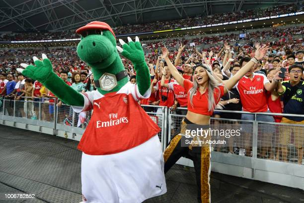 Arsenal mascot Gunnersaurus cheers with fans during the International Champions Cup match between Arsenal and Paris Saint Germain at the National...