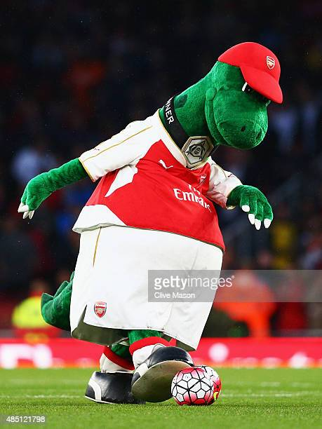 Arsenal mascot Gunnersaurus kicks a ball prior to the Barclays Premier League match between Arsenal and Liverpool at Emirates Stadium on August 24...