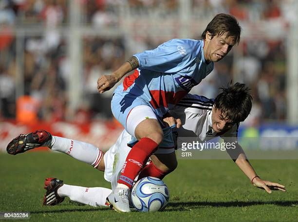 Arsenal midfielder Alejandro Gomez struggles with River Plate midfielder Rodrigo Archubi during an Argentina's First Division football match at Jose...