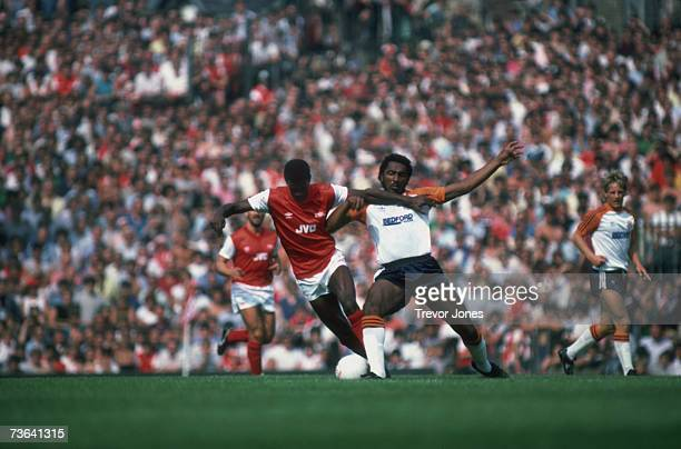 Arsenal midfielder Paul Davis is challenged by Luton player Ricky Hill during the opening match of the season at the Arsenal Stadium in Highbury,...