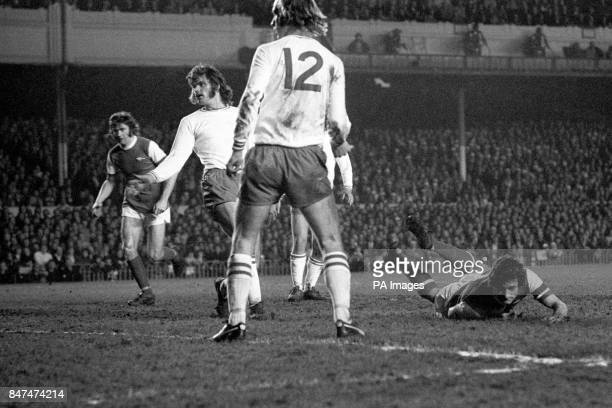 Arsenal No 5 Frank McLintock makes a pancake landing but Ajax Amsterdam players keep their eyes on the ball after his low header