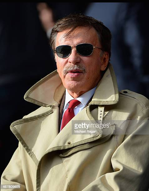 Arsenal owner Stan Kroenke watches from the stands during the Barclays Premier League match between Liverpool and Arsenal at Anfield on February 8...