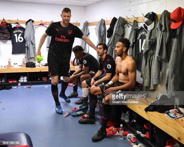 Arsenal Per Mertesacker Henrikh Mkhitaryan and PierreEmerick Aubameyang in the changing room after the Premier League match between Huddersfield Town...