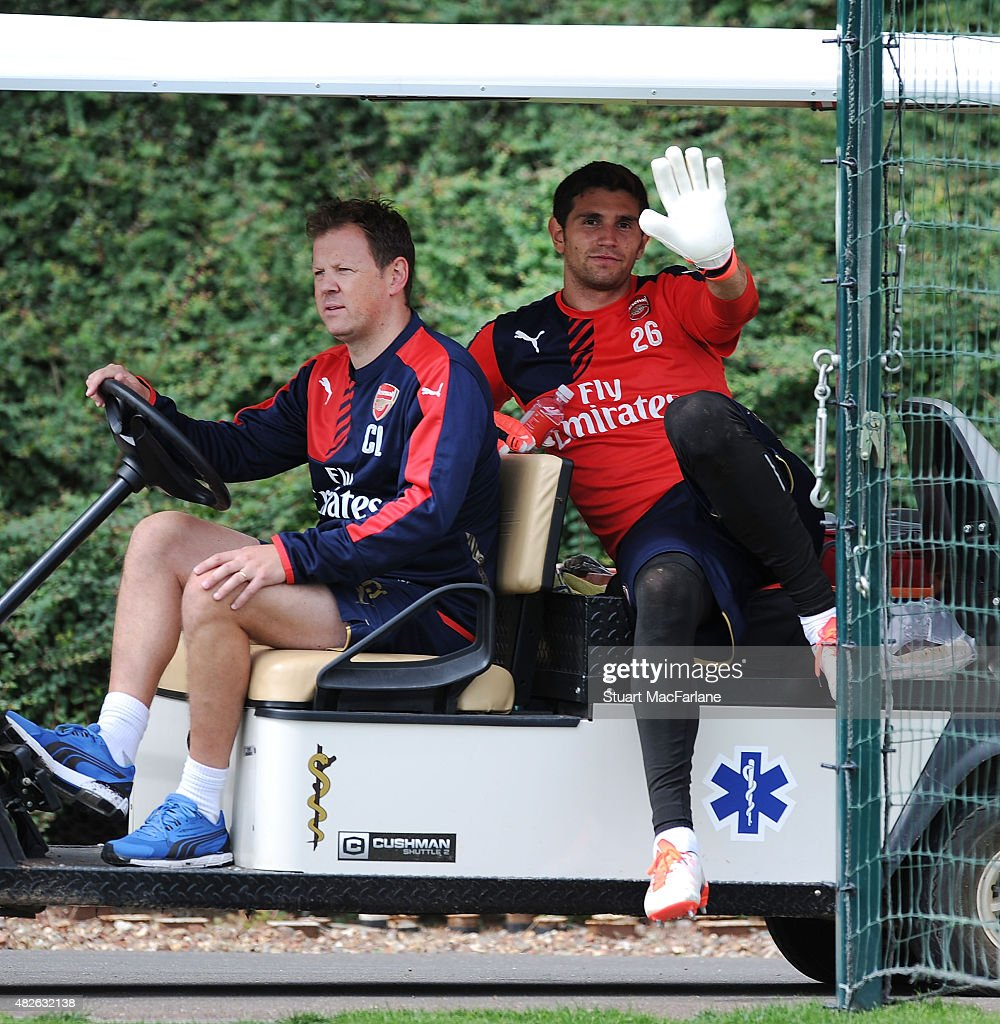 Arsenal physio Colin Lewin with Emiliano Martinez during a training session at London Colney on August 1, 2015 in St Albans, England.