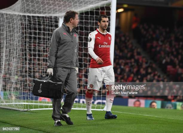 Arsenal physio Colin Lewin with the injured Henrikh Mkhitaryan during the UEFA Europa League quarter final leg one match between Arsenal FC and CSKA...