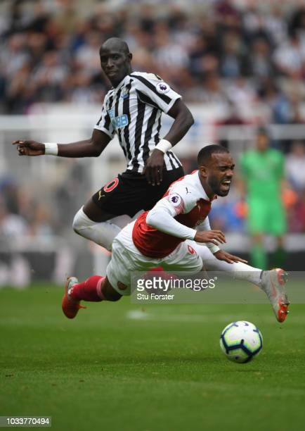 Arsenal player Alexandre Lacazette is fouled by Mohammed Diame of Newcastle during the Premier League match between Newcastle United and Arsenal FC...