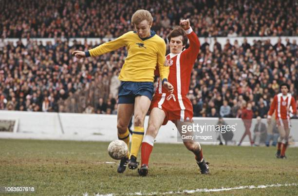 Arsenal player David Price in the yellow change kit is challenged by Orient defender Glenn Roeder during the 1978 FA Cup Final Semi Final match at...
