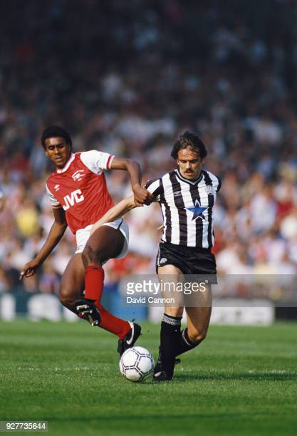Arsenal player David Rocastle challenges Alan Davies of Newcastle United during a First Divsion match at Highbury on September 28 1985 in London...
