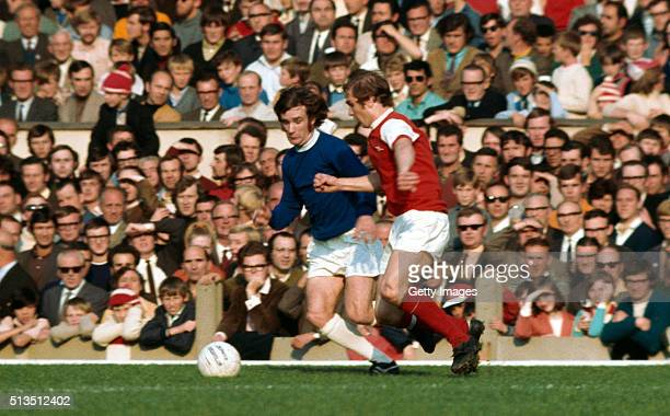 Arsenal player Eddie Kelly challenges Colin Harvey of Everton during a First Division match at Highbury on October 17, 1970 in London, England,...