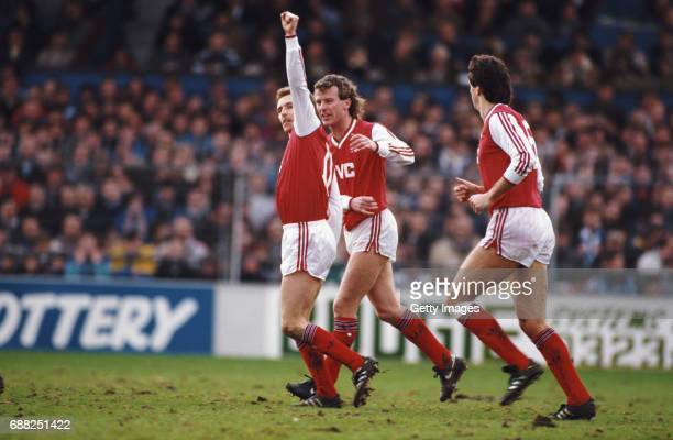 Arsenal player Kevin Richardson celebrates the winning goal with Graham Rix and David O' Leary during an FA Cup 4th Round match against Brighton and...