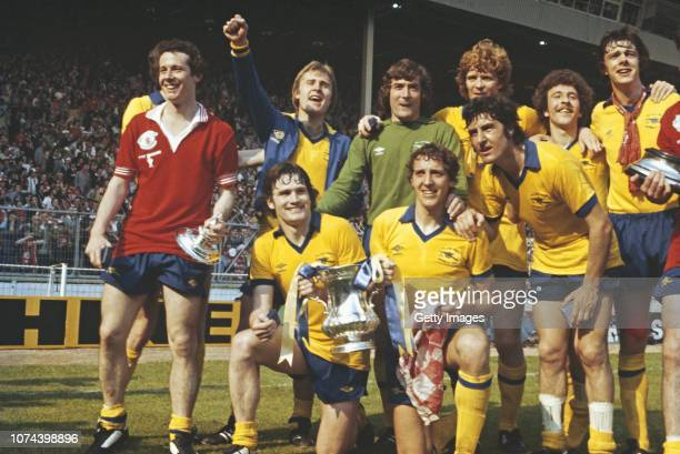 Arsenal player Liam Brady wearing a Manchester United shirt leads the celebrations after their 32 victory in the 1979 FA Cup Final at Wembley Stadium...