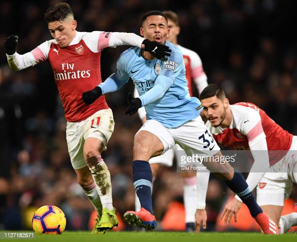 Arsenal player Lucas Torreira challenges Gabriel Jesus of City during the Premier League match between Manchester City and Arsenal FC at Etihad...