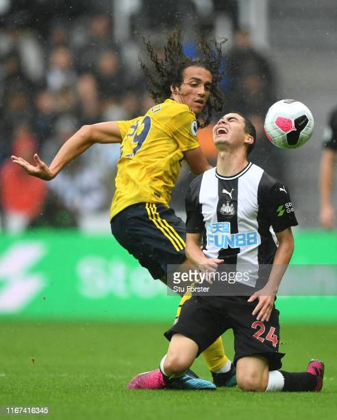 Arsenal player Matteo Guendouzi fouls Miguel Almiron of Newcastle during the Premier League match between Newcastle United and Arsenal FC at St James...