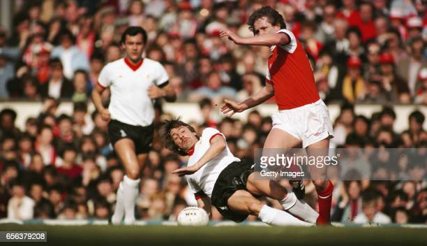 Arsenal player Peter Nicholas evades a challenge from Liverpool winger Steve Heighway as Ray Kennedy looks on during a First Division match at...
