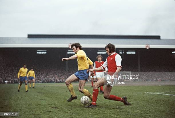 Arsenal player Peter Simpson is challenged by Kevin Hector of Derby during a First Divsion match between Arsenal and Derby County at Highbury on...