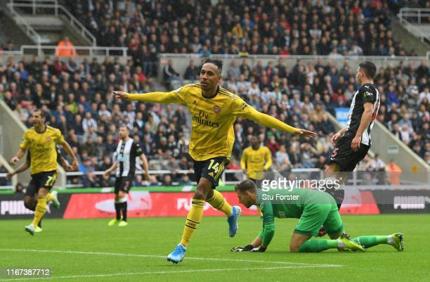 Arsenal player PierreEmerick Aubameyang celebrates after scoring the winning goal during the Premier League match between Newcastle United and...