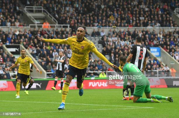 Arsenal player Pierre-Emerick Aubameyang celebrates after scoring the winning goal during the Premier League match between Newcastle United and...