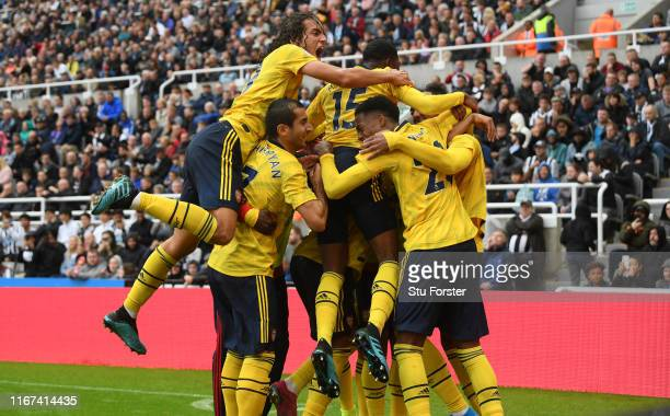 Arsenal player PierreEmerick Aubameyang celebrates with Matteo Guendouzi and team mates after scoring the winning goal during the Premier League...