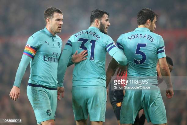 Arsenal players Aaron Ramsey Sead Kolasinac and Sokratis Papastathopoulos looks on during the Premier League match between Manchester United and...