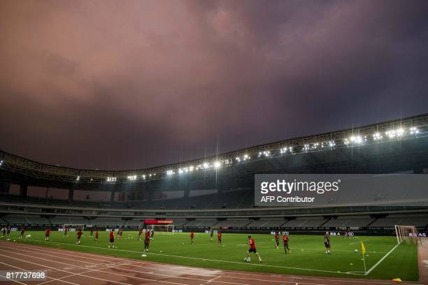 Arsenal players attend a training session ahead of the International Champions Cup football match between Bayern Munich and Arsenal in Shanghai July...