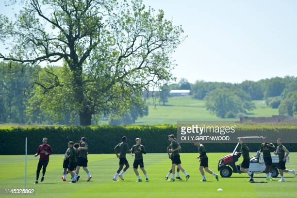 Arsenal players attend a training session at Arsenal's London Colney training centre in St. Albans on May 21, 2019 ahead of their Europa League final...