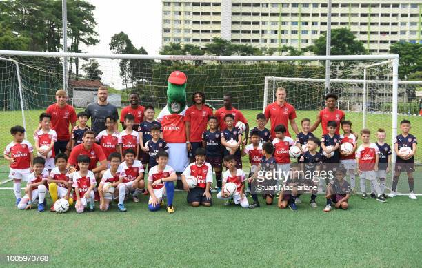 Arsenal players attend an Arsenal Soccer Clinic at the Singapore American School on July 27 2018 in Singapore