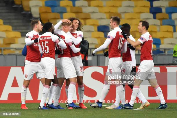 Arsenal players celebrate a goal during UEFA Europa League Group E football match Vorskla FC vs Arsenal FC at the Olympiyski Stadium in Kiev on...