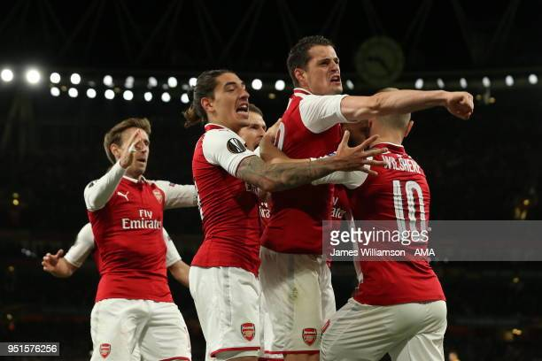 Arsenal players celebrate after Alexandre Lacazette of Arsenal celebrates after scoring a goal to make it 10 during the UEFA Europa League Semi Final...
