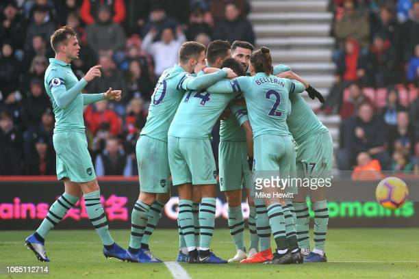 Arsenal players celebrate after Jefferson Lerma of AFC Bournemouth scores an own goal during the Premier League match between AFC Bournemouth and...