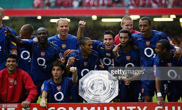 Arsenal players celebrate after they win the Community Shield match between Arsenal and Manchester United at the Millennium Stadium on August 8 2004...