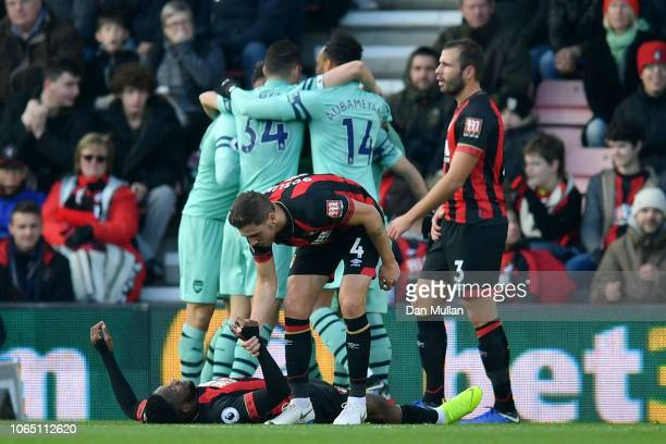 Arsenal players celebrate as Jefferson Lerma of AFC Bournemouth reacts after scoring an own goal during the Premier League match between AFC...