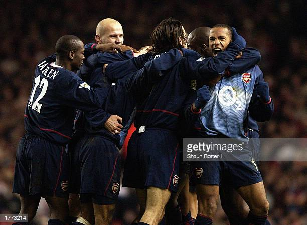 Arsenal players celebrate during FA Barclaycard Premiership match between Liverpool and Arsenal held on January 29 2003 at Anfield in Liverpool...