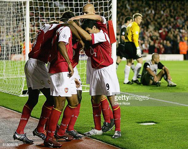 Arsenal players celebrate the opening goal during the UEFA Champions League Group E match between Arsenal and PSV Eindhoven at Highbury on Septemner...