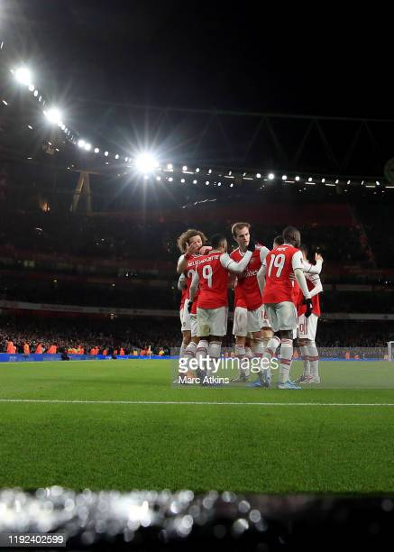 Arsenal players celebrate the winning goal during the FA Cup Third Round match between Arsenal and Leeds United at Emirates Stadium on January 6 2020...