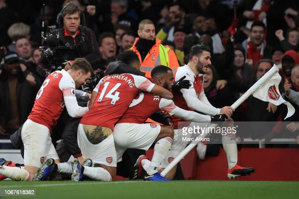 Arsenal players celebrate their 3rd goal during the Premier League match between Arsenal FC and Tottenham Hotspur at Emirates Stadium on December 2...