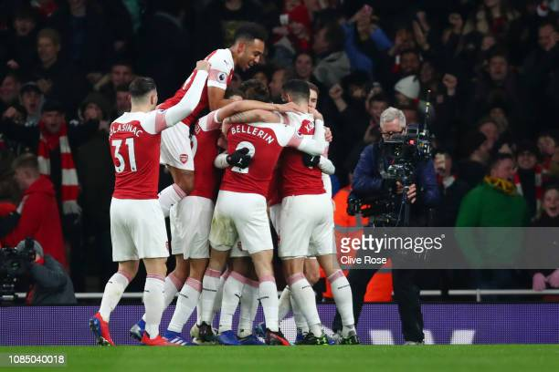 Arsenal players celebrate their first goal during the Premier League match between Arsenal FC and Chelsea FC at Emirates Stadium on January 19 2019...
